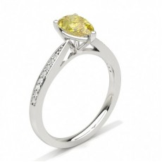Prong Set Yellow Diamond Side Stone Engagement Ring