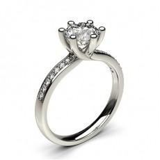 Bague de fiançailles solitaire épaulé diamant rond serti 6 griffes et pavé