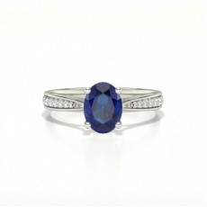 Oval 4 Prong Setting Side Stone Blue Sapphire Engagement Ring