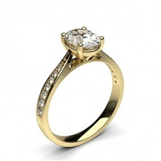 Oval Yellow Gold Side Stone Diamond Engagement Rings