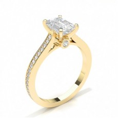 Emerald Yellow Gold Side Stone Engagement Rings
